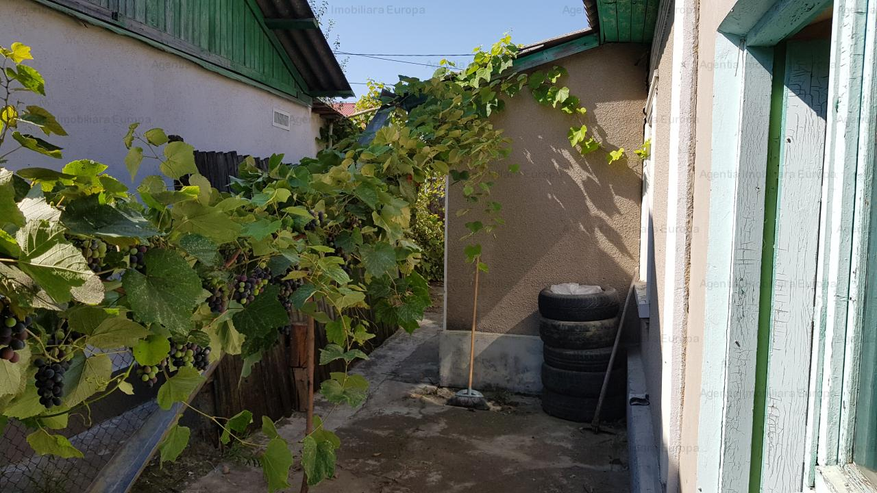 Casa si teren zona Linistita