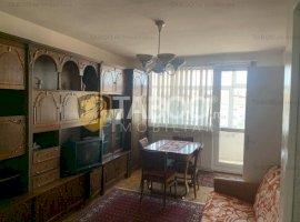 Apartament de vanzare cu 3 camere 2 garaje acoperite Lupeni in Sibiu